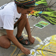 Pavement artist draws a grasshopper